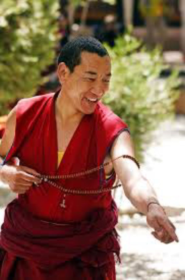 Laughing monk, beads, finger
